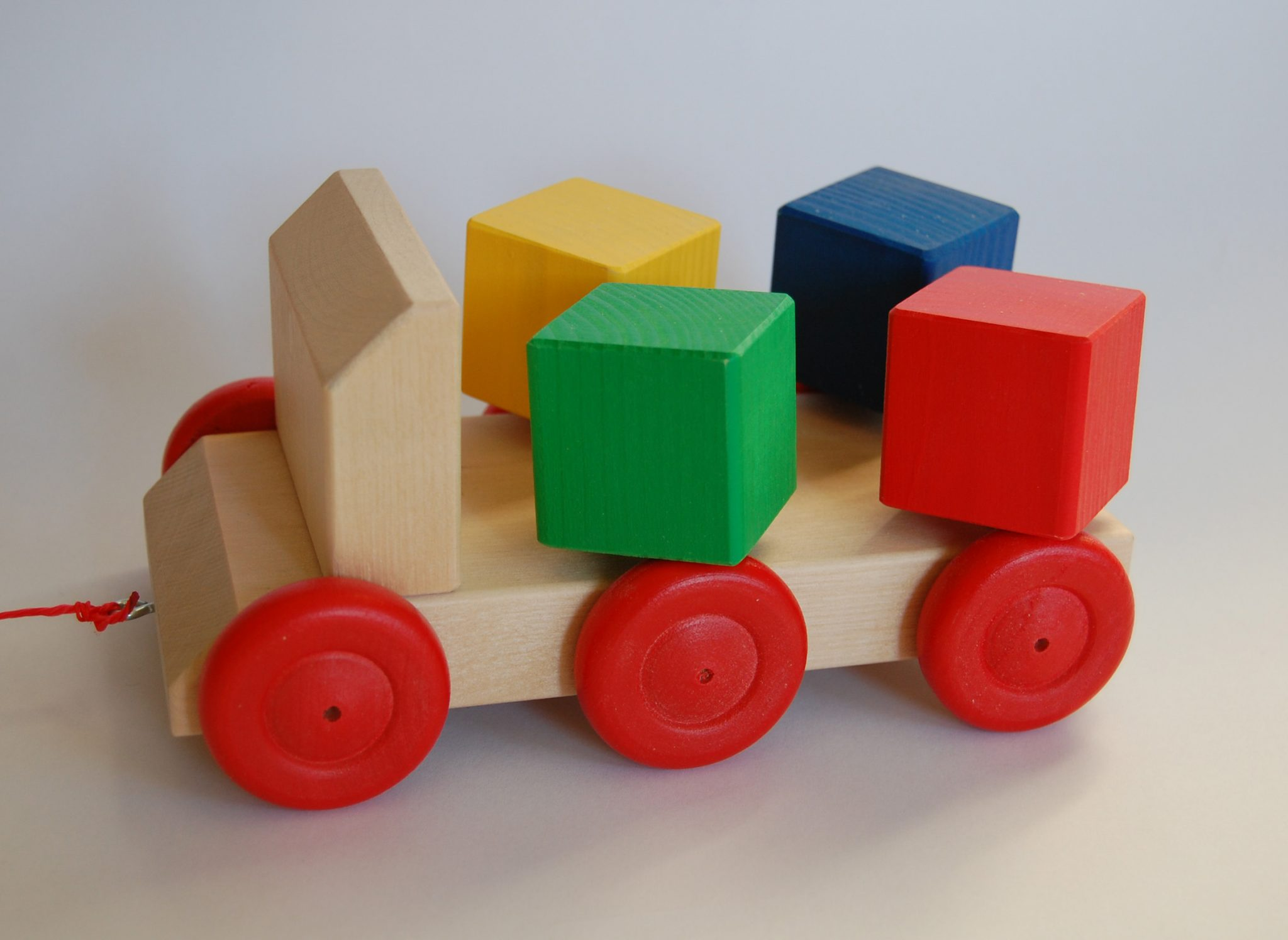 a wooden car with blocks